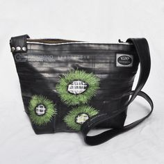 "Eco-friendly bag made from recycled bike inner tubes - ""Fireworks"". $160.00, via Etsy."