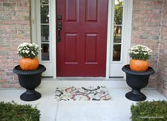 Here's an interesting idea for fall porch decor. Use carved pumpkins as planters for cold-hardy mums. Clever!