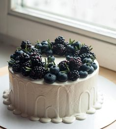 White cake with berries.
