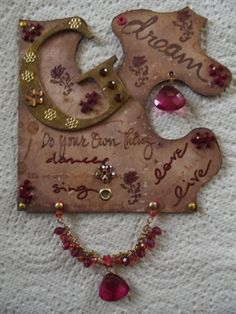 Altered jig-saw piece.  Distressed and embellished. For my sister Gill.
