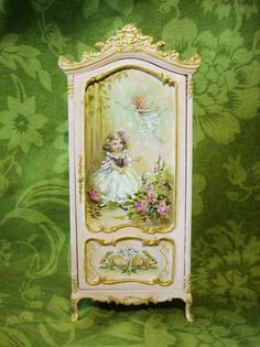 Part of the Finding Fairies Collection in a soft pink. Original, hand-painted fairytale art on a miniature cupboard with dancing fairies, rabbits, roses and forget-me-nots. Approx. 7 tall NOTE: Made to order. Please allow approx. 10 to 12 weeks for shipping from purchase or final