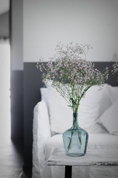Colored vases (blue, brown, clear) with baby's breath