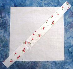 Photo of string quilt block with one fabric strip laid on top