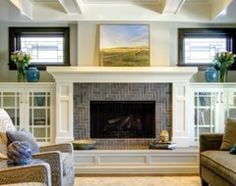 Fireplace remodel - Houzz rather than demoing, how about framing around it and adding slate tile to the hearth