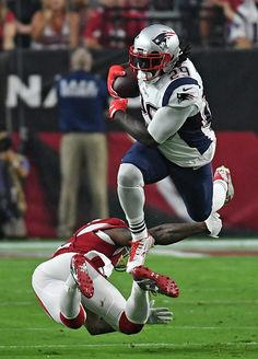 Running back LeGarrette Blount of the New England Patriots carries the ball…