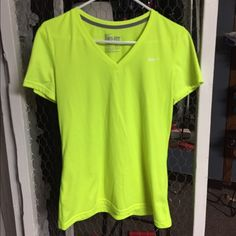 Nike Dri-Fit shirt Maybe worn once, perfect condition. Lime green/bright yellow Nike Tops Tees - Short Sleeve