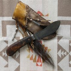 Primitive Nessmuk Mountain Man knife with custom fit deer rawhide sheath.  by Miss Tudy on Etsy
