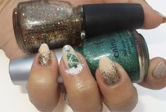 Loving this red & green glitter gradient with a sparkly green Christmas tree accent nails! The star on top of the tree too!