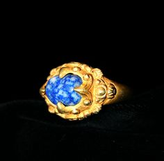 Lapis Lazuli Set in Gold Ring - GC.39 Origin: Indonesia Circa: 18 th Century AD to 19 th Century AD Collection: Jewelry Medium: Lapis Lazuli, Gold Condition: Fine