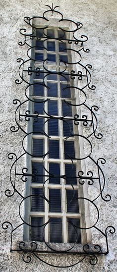 Decorative iron grill over window. COURMAYEUR – LA SAXE (Valle d'Aosta) - Italy - by Guido Tosatto