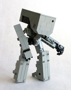 """Mech from GAINAX series """"Gunbuster You can see the leg stabilizers extended here. Lego Robot, Lego War, Military Robot, Lego Creative, Lego Sculptures, Lego Craft, Frame Arms Girl, Lego Mechs, Minecraft Tutorial"""