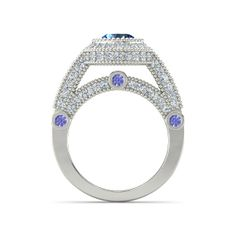 The Vanessa Ring customized in blue topaz, diamond, tanzantie and white gold