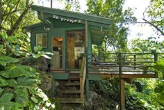 250 Sq ft Treehouse featuring full size bed, kitchenette & bathroom.