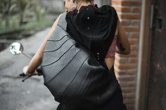 """""""Croissant"""" Bag - (this bag fits UFO drum), unick design, different/malty ways of wearing, has 3 inside pockets. <ul> <li>Made from<strong>upcycled</strong>motorcycle tires.<strong>100% vegan</strong>.</li> <li>They are<strong>very strong</strong>, usable, quite big and<strong>waterproof</strong>.</li> <li>Inside weuse<strong>Handmade</strong>native Javanese Batik.</li> </ul>"""