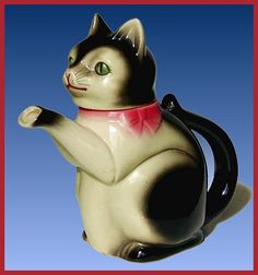 I have a teapot similar to this one, but it's all black. It looks like a maneki nekko cat to me.    teapot