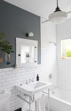 Before & After: A DIY Couple Tackle Their 1915 Craftsman in San Diego - Photo 19 of 20 - White subway tiles and dark grout give the new bathroom a crisp, clean look. Grey Grout Bathroom, White Subway Tile Bathroom, Tiled Walls In Bathroom, White Tiles Grey Grout, Bath Tiles, Bathroom Cabinets, Bathroom Vanities, Bathroom Interior, Modern Bathroom