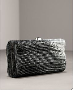 Minaudiere: a small evening bag embezzled with pieces of metal, semi precious stones or beads or covered with fabric or leather.  Haleymatul Jannah FD1A1