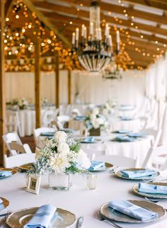 Wedding Reception Tablescape With Champagne Gold Charger Plates And Light Blue Linen Napkins Low White Hydrangea Centerpieces