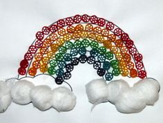 rainbow with colored pasta and cotton balls