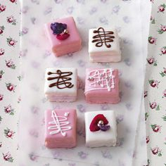 Petits fours with chocolate decorating
