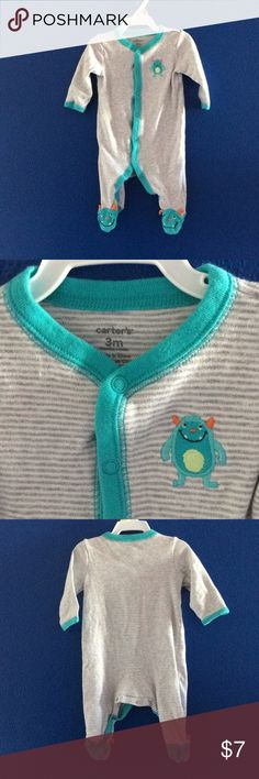 Carter's monster footed pajama grey stripes 3M Carter's brand. Size 3months. Grey and white stripes. Monster decals on chest and decor on feet. Turquoise and orange monsters. Teal edging on wrists and neckline. Button snap up. Gently used sleep n play pajama. Very cute onesie for babyboy or girl gender neutral. bundle and save 20% with other items in my closet. Carter's One Pieces Footies