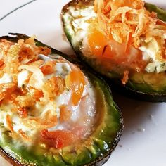 Baked avocado with bacon, egg, cream cheese and fried onions