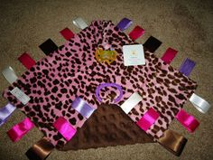 Taggie blanket with pacifier holder