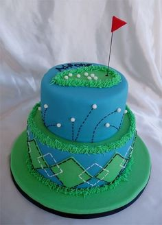 Blue and green golf cake, all MMF with wire flag on top. I found inspiration for this one from all the golf cakes on this site.