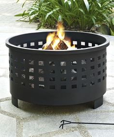 Bring a cozy addition to the home with this quality crafted fire pit! Featuring a deep bowled pit and a punched lattice pattern to ventilate the fire, it's an outstanding addition to backyard décor.