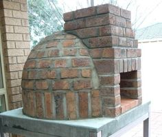 Suppose you were inspired by the cheap DIY home pizza oven—but weren& so sure your home insurance would cover oven modifications. It& time to build a safer, more eye-pleasing oven, and we& got a thorough guide. Home Pizza Oven, Pizza Oven Outdoor, Outdoor Cooking, Outdoor Kitchens, Brick Oven Outdoor, Build A Pizza Oven, Pizza House, Brick Bbq, Outdoor Bars