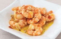 Tapas are a wide variety of appetizers, or snacks, in Spanish cuisine. They may be cold (such as mixed olives and cheese) or hot such as in this recipe for chilli and garlic king prawns. In select … Easy Prawn Recipes, King Prawn Recipes, Tapas Recipes, Chilli Recipes, Quick Recipes, Fish Recipes, Seafood Recipes, Cooking Recipes, Tapas Ideas