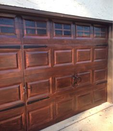 We recently painted our house and so our garage door needed to be painted as well. I decided not to repaint it because I was hoping the old rust paint would sho… Faux Wood Garage Door, Metal Garage Doors, Garage Door Paint, Garage Door Makeover, Metal Garages, Garage Door Design, Painting Garage Doors, Faux Garage Door Windows, Big Doors