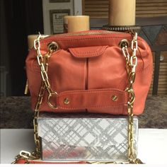 Tory Burch Orange Leather Mini Satchel- Crossbody AMAZING DEAL! Authentic Tory Burch Happy Orange Dena Mini Satchel- Genuine Leather with Gold Tone Hardware- Great Condition; interior very clean, exterior in great shape besides tiny pen markings on one side as seen in picture #4- priced accordingly. Genetic dust bag included- Retail $395.00 Tory Burch Bags Crossbody Bags