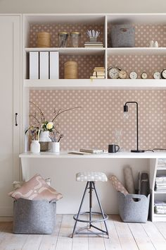 dusky pink works well in this office against the greys and white washed floor boards