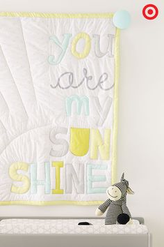 The Circo You Are My Sunshine 4-piece Crib Bedding Set is the perfect neutral addition to Baby's nursery. This bedding set features soft grays, greens and yellows, and includes a coordinating baby blanket, dust ruffle, comforter and fitted crib sheet, each adorned with little happy suns. Shine on!