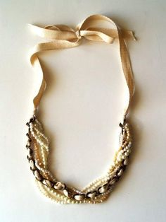 DIY Necklace....maybe use old necklaces that you're tired of and place them together?