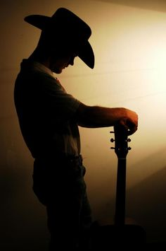 Cowboy with guitar...now if that isn't cool!!! It'd make a nice silhouette painting too!