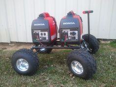 Honda Eu2000i cart I made to carry my Generators. It has coil over shocks, working suspension and aluminum kart wheels with knobby tires.