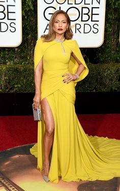 Jennifer Lopez made jaws drop in her marigold Giambattisa Valli dress, complete with a cape, Jimmy Choo shoes and 200 carats of diamond baubles. See more of the Golden Globes' best dressed stars here!