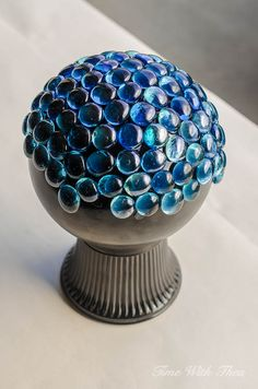 Apply turquoise glass gems in sections to the spray painted glass globe light / timewiththea.com