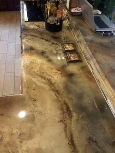 Stained concrete counter tops, we'll be doing this concrete counters in our kitchen later this year, never seen this color before.  perfect.  - Originally pinned by Barb Paige onto Cabin ideas