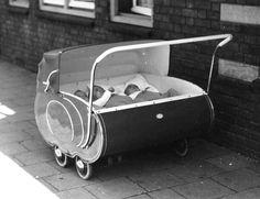 A unique triplets sized pram, 1940's.
