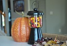 Gumball machine from salsa jar, terracotta pot (take the salsa jar with you to find the perfect fit) black paint