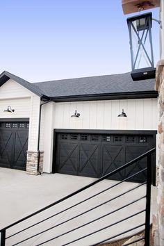 Farmhouse garage. Great rustic look + black and white contrast.