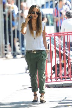 Jessica Alba - street style wearing a slouchy white t-shirt; khaki cargo pants & studded black belt, leopard ankle strap flats