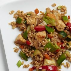 "Veggie-Packed Chicken Fried Rice | ""This better-than-takeout main dish cuts the grease and loads up on fresh vegetables. Get your kids involved by letting them choose which vegetables they want to include."""
