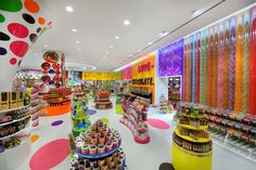 Interior wall of Candylicious in Dubai. This shop in the mammoth Dubai Mall is probably as close as you can come to a real-life candy experience. The Candylicious flagship is 1,000 square meters (10,000 sq ft.) making it the largest candy store in the world. Before you even get to the store you'll likely see the Candylicous Car circling about. Highlights inside the store itself: a lollipop tree, a Candylicious Airplane kids can ride and an old-timey soda fountain.