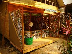 "This is a bottle bricking shed. Love that the walls are made of open ""bottlebrick"" work."