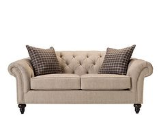 A pleasing mix of relaxed and refined, this Harlow chenille loveseat will add distinction to your living space. The rolled arms and back are enhanced with sophisticated button tufting and nailhead trim. Neutral silver chenille combines an upscale look and feel with family-friendly durability and can be paired with rich colors or other gray tones and neutrals for design versatility. Decorative turned feet and accent pillows complete the look.