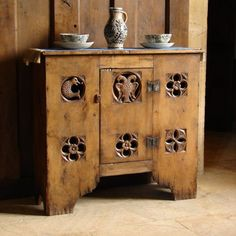 Tudor aumbry cupboard in oak. In the Middle Ages an aumbry was a cabinet in the wall of a Christian church or in the sacristy which was used to store chalices and other vessels, as well as for the reserved sacrament.